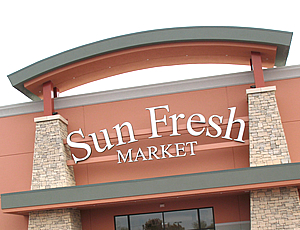 Exterior photo of a Sun Fresh store front.